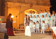 Solo singer Alexia with choir